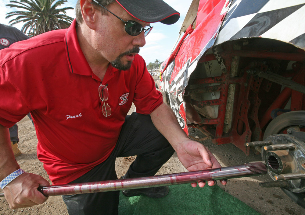 Speedway Engineering's Frank Ferrell takes a look at the condition of a racer's axle.